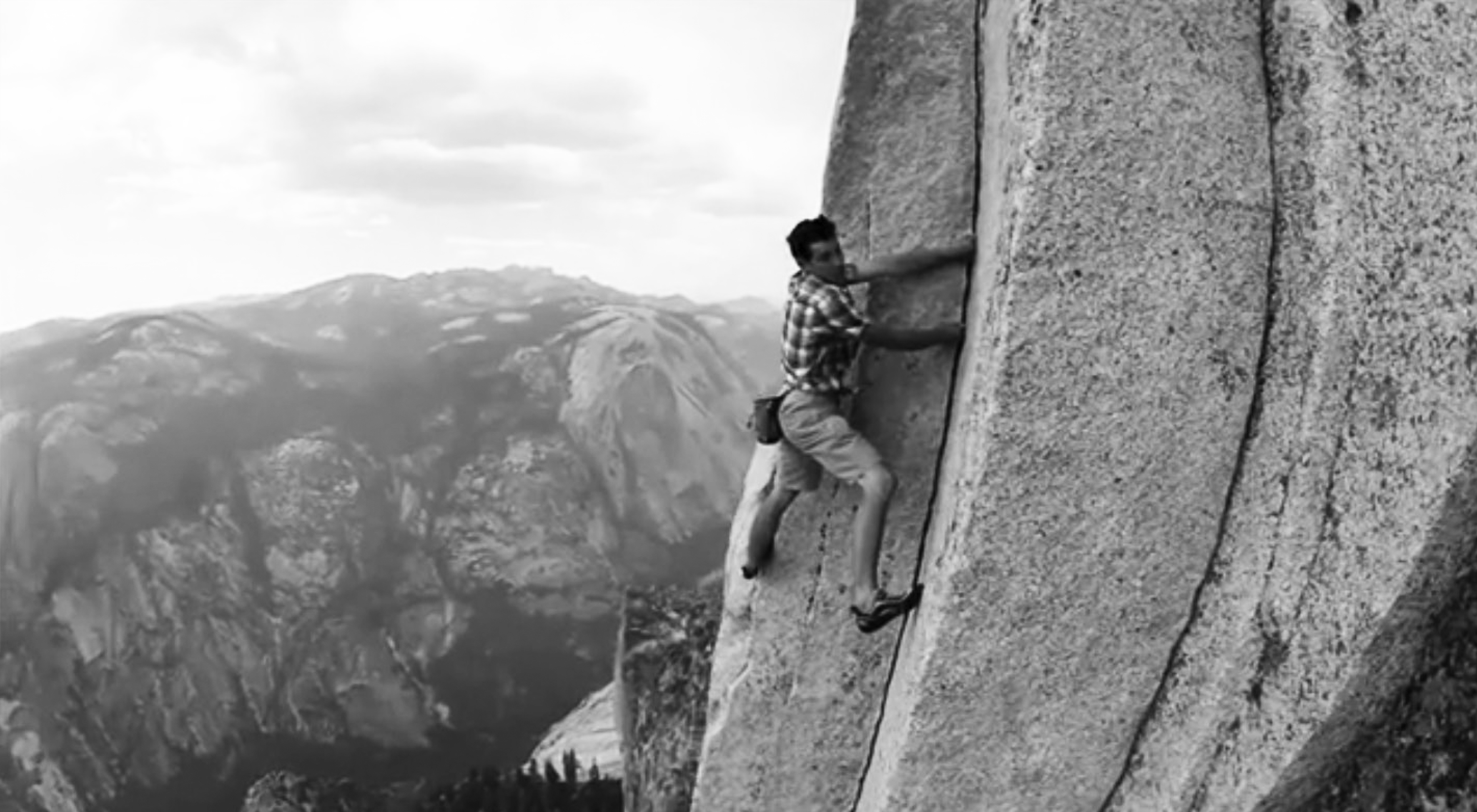 Free-solo climber climbing Half Dome in Yosemite National Park